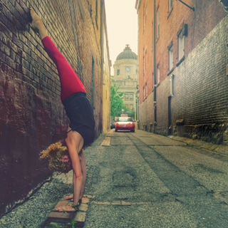 Handstand in the Shadow of Courthouse